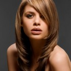 Haircuts with side bangs and layers